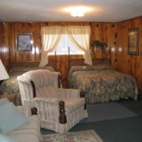 Butch Cassidy Two room two bath and kitchen lodging for 6 Red River NM at Mountain Shadows Lodge